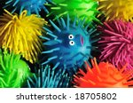 One wide-eyed squishy puffer fish lost in a sea of color - stock photo