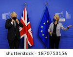 Small photo of European Commission President Ursula von der Leyen welcomes British Prime Minister Boris Johnson prior to a meeting at EU headquarters in Brussels, Belgium on Dec. 9, 2020.