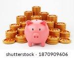 piggybank and money tower on... | Shutterstock . vector #1870909606