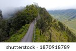 Asphalt road with foggy on the mountain top, Top hill view From Bromo a wonderful scenery in dramatic hill - stock photo