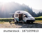 Small photo of Vintage camper van parked on campground or camping in forest. Beautiful sunny morning in wild camp spot. Nomadic vanlife lifestyle. Relaxed simple vacation. RV camping destination