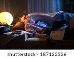 tired businessman sleeping on... | Shutterstock . vector #187122326