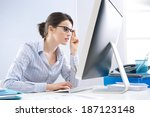 young office worker staring at... | Shutterstock . vector #187123148