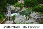 A Footbridge Above A Rapid...