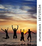 silhouette of jumping people on ... | Shutterstock . vector #187155134