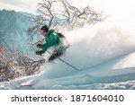 Man Skier In Green Jacket Is...