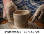 hands of a potter  creating an... | Shutterstock . vector #187163726
