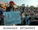 Small photo of Haryana, India December 9 2020: A Sikh farmer showing an anti government poster during Farmer protest at Singhu border.