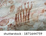"""Small photo of Detail of the paintings on a rock in """"La Lindosa"""", Guaviare. Primitive art on red pigments over a white natural rock, paintings of animals an tribal patterns. Near Chiribiquete formation"""