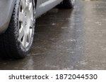 Ice crusted ground  car wheel...