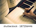 written on the piano sheet music | Shutterstock . vector #187206446