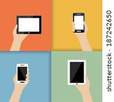 devices in hand. in color. ...