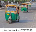 Small photo of DELHI, INDIA - MARCH 17, 2014: Auto rickshaws, known as Tuk-Tuks, dominate roads around the Indian capital , providing a cheap taxi service for the local populace and tourists alike