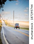 Small photo of Amish buggy on isolated country road
