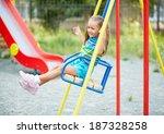 happy little girl swinging on... | Shutterstock . vector #187328258