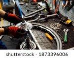 Bicycle Repair In Workshop  Man ...