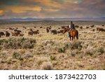 A Cowboy Riding Through A Sage...