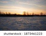 Winter Sunset On A Frozen River