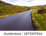 Mountain Asphalt Road Leading...