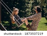 Young Woman Swinging With Her...
