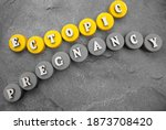 Small photo of Ectopic Pregnancy, word cube with background.