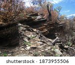 Layered Rock Against A Slope Of ...