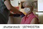 A Senior Woman Wearing A Mask...