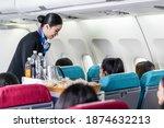 Asian Female Flight Attendant...