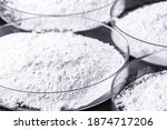 Small photo of Calcium carbonate, the result of the reaction of calcium oxide with carbon dioxide. Being prepared in petri dish