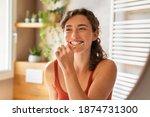 Smiling Young Woman Brushing...