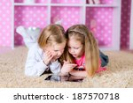 little kids playing on a tablet ... | Shutterstock . vector #187570718