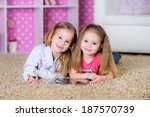 little kids playing on a tablet ...   Shutterstock . vector #187570739
