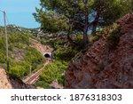 a railroad tunnel in the... | Shutterstock . vector #1876318303