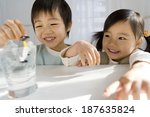 children playing with toy... | Shutterstock . vector #187635824