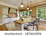 Stock photo luxury kitchen room with island and chairs 187661096