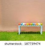 chair on green grass    wooden... | Shutterstock . vector #187739474