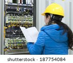 woman checking network cables | Shutterstock . vector #187754084