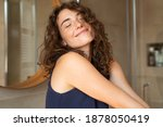Small photo of Happy young woman feeling relaxed with eyes closed. Smiling woman stretching with hands forward feeling fresh on a bright morning. Beautiful girl stretch herself in the morning.