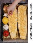 woman preparing yellow zucchini ...