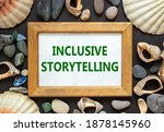 Small photo of Inclusive storytelling symbol. Wooden picture frame with inscription 'Inclusive storytelling' on beautiful black background. Sea stones and seashells. Business and inclusive storytelling concept.