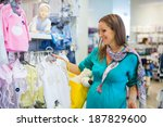 Young Pregnant Woman Choosing...