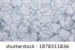 Small photo of Hexagon marble or granite tiles newly installed on the kitchen backsplash, modern design of gray and white porcelain flooring tiles and it can be install on shower walls or floors. Showroom detail.