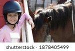 asian shool kid girl with horse ... | Shutterstock . vector #1878405499