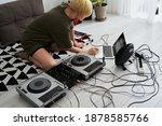 Woman Making Electronic Music...