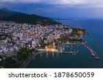 Aerial panoramic view of Volos city with Pelion Mountain on background. Magnesia - Greece.