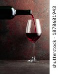 Red Wine Is Poured From A...