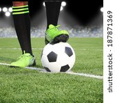 soccer ball with feet player on ... | Shutterstock . vector #187871369