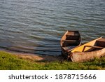 Two Rowboats Are Moored To The...