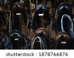 Leather Horse Saddles Hanging...