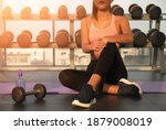 workout in gym by a beautiful...   Shutterstock . vector #1879008019